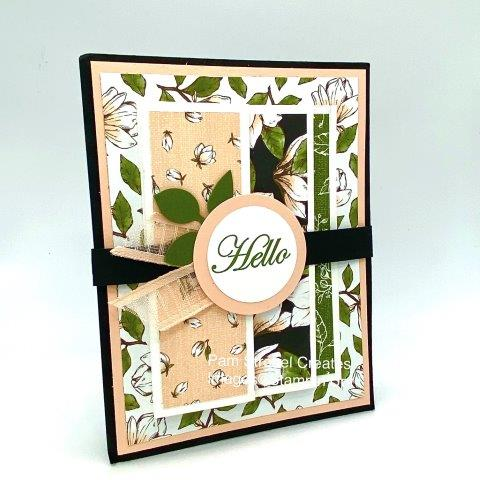 HELLO...it's center stage and part of the sweetly decorated belly band hiding a design underneath . Slide it off and find an accordian style card. Magnolia Morning stamp set using Magnolia Lane Designer Series Paper, Petal Pink, Mossy Meadow and Basic Black. Find the inside look at my website here :https://www.pamstrobelcreates.com/magnolia-morning-stamp-set